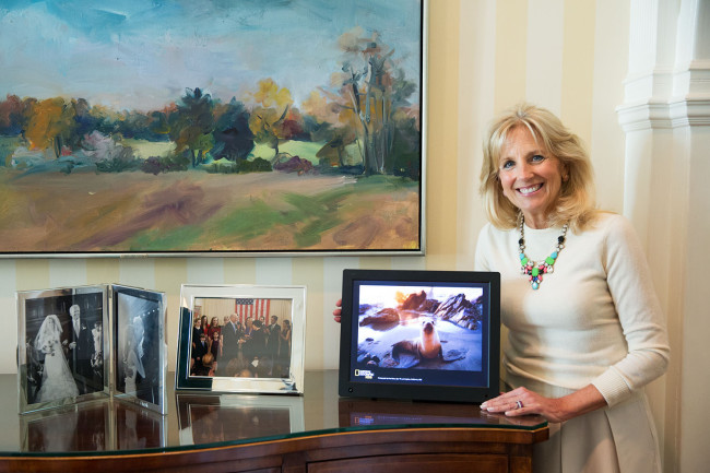 Dr. Jill Biden poses with a digital picture frame with rotating photos taken by young photographers from the National Geographic Kids My Shot photo community at the Vice President's Residence, in Washington, D.C., May 13, 2015. White House Photo by David Lienemann This photograph is provided by THE WHITE HOUSE as a courtesy and is for use by Nat Geo Kids Magazine. This image may be posted on kids.nationalgeographic.com only as a low resolution file in conjunction with the same issue of the magazine. This photograph may not be manipulated in any way and may not otherwise be archived, reproduced, disseminated, or broadcast without the written permission of the White House Photo Office. This photograph may not be used in any commercial or political materials, advertisements, emails, products, promotions that in any way suggests approval or endorsement of the Vice President, Dr. Jill Biden, or the White House.
