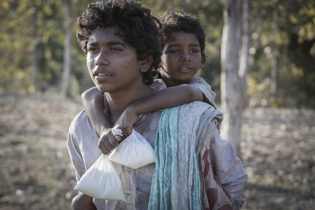 Sunny Pawar and Abhishek Bharate in Lion (2016) Titles: Lion People: Sunny Pawar, Abhishek Bharate Characters: Saroo Brierley © Long Way Home Productions 2015 Source: ImBD: http://www.imdb.com/title/tt3741834/mediaviewer/rm3545238528